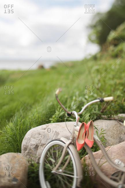 High heels on bicycle handlebars