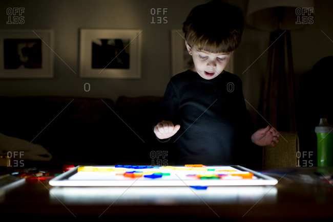 Young boy playing with illuminated toy