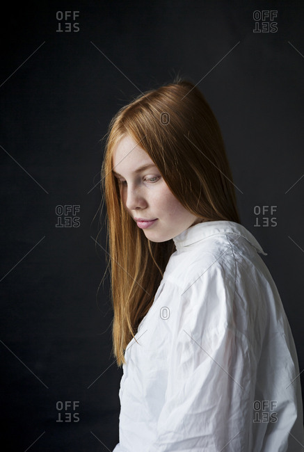 Portrait of a beautiful teen girl with long red hair