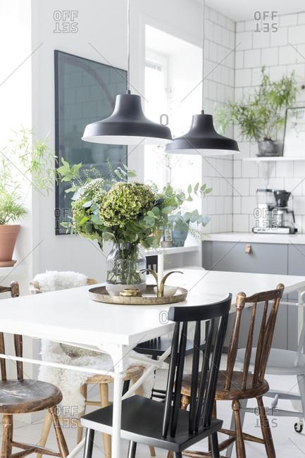 Modern kitchen interior with hydrangeas on table