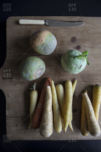Overhead view of root vegetables on a cutting board