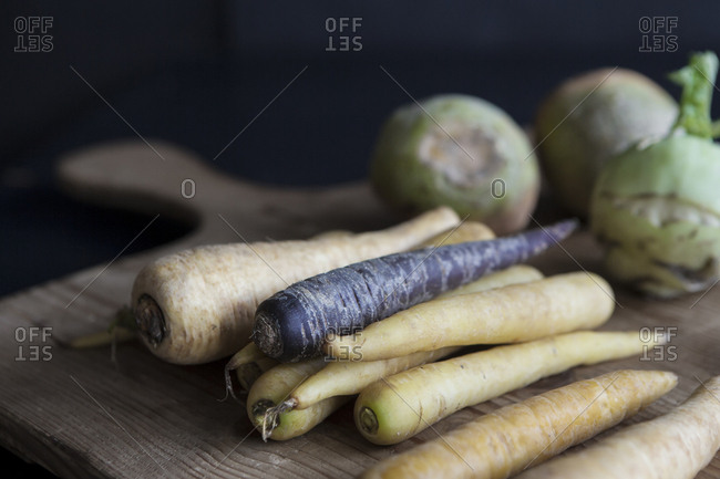 Close up of root vegetables on a cutting board