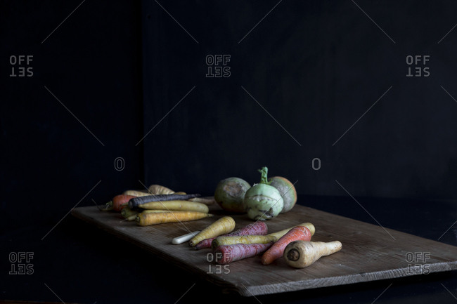 Colorful root vegetables on a cutting board