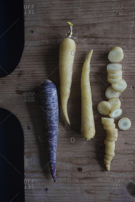 Overhead view of root veggies on a cutting board