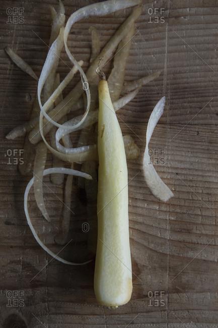 Freshly peeled parsnip on a cutting board