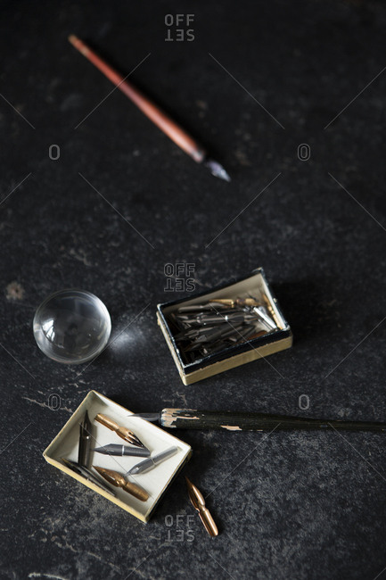 Overhead view of antique pen and tips