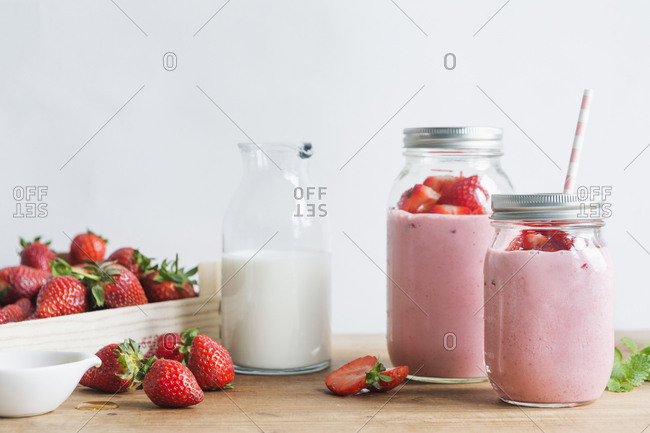 Strawberry and sweat pea smoothies with fresh strawberries