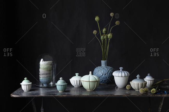 Ceramics and poppy and eucalyptus plants