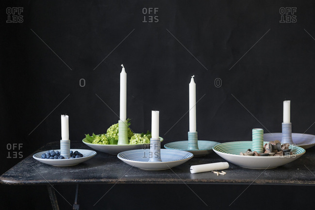 Candle sticks in striped holders