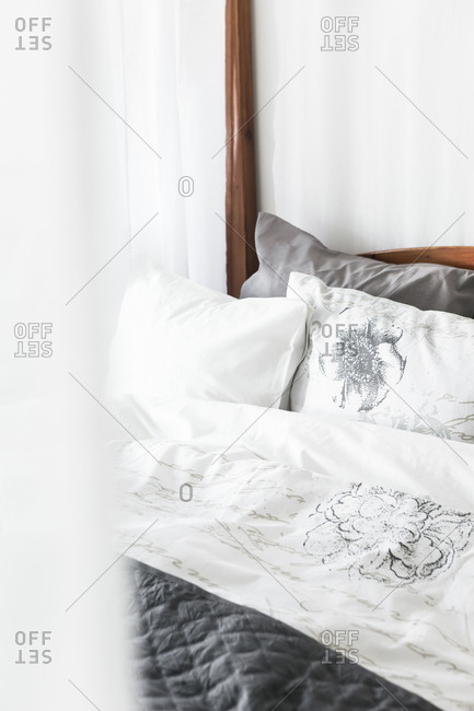 Bed with floral bed sheets