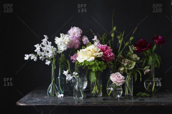 Variety of flowers in vases
