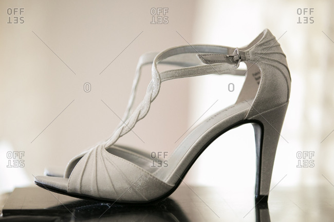Pair of elegant silver high-heeled sandal