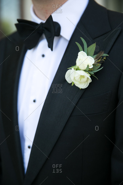 Groom in a black tuxedo and black bowtie