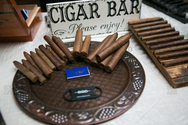 Handmade cigars on a serving tray at a wedding reception
