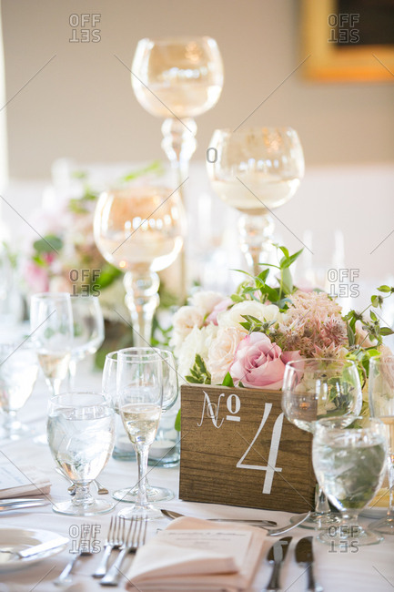 Table number and candleholders on a table at a wedding reception