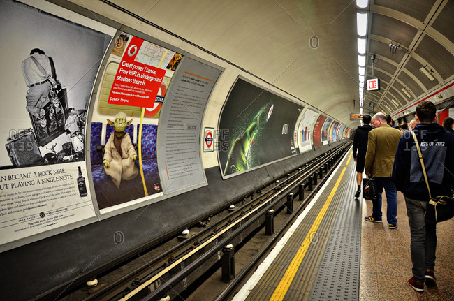 May 20, 2013 - London, England: Commuters waiting on tube station platform