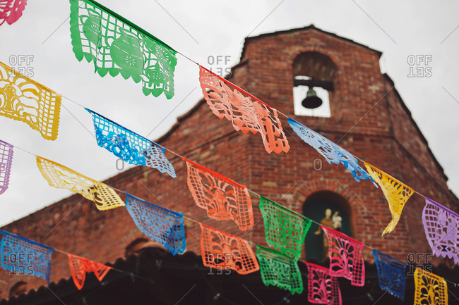 Festive Mexican banner hanging outside historic brick building in San Antonio, TX