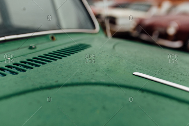 Detail of hood of green antique car