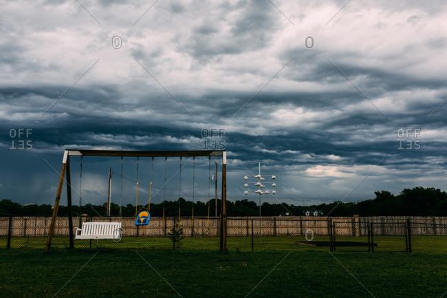 Storm clouds over backyard swings