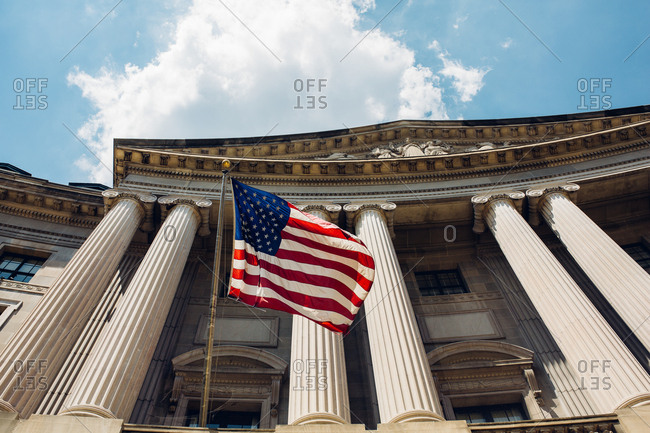 American flag hanging on columned building