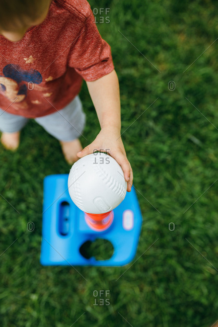 Elevated view of child playing t-ball