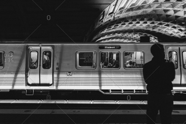 May 31, 2016 - Washington, DC: Man silhouetted in front of passing train in subway