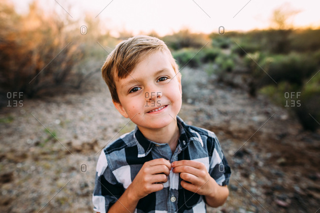 Portrait of a cute young boy in desert landscape