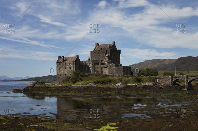United Kingdom, Scotland, Dornie, Eilean Donan Castle reflecting in water