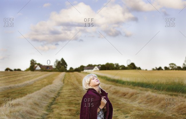 Denmark, Mon, Girl with eyes closed in non urban setting