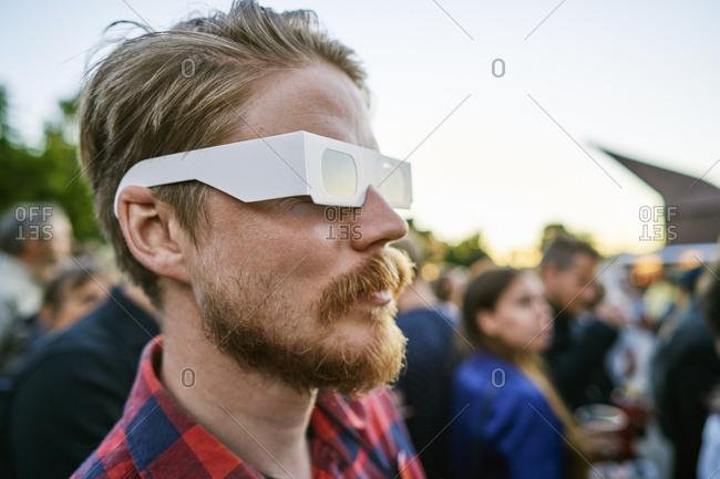 Sweden, Uppland, Stockholm, Djurgarden, Portrait of blonde man with glasses at concert