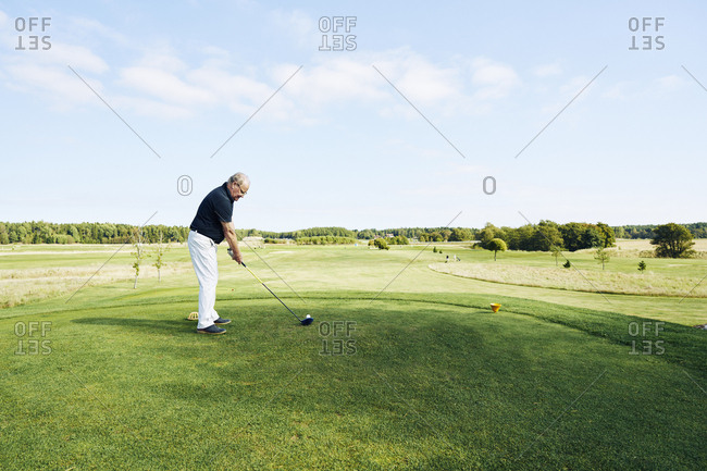 Sweden, Sodermanland, Haninge, Vasterhaninge, Senior man playing golf