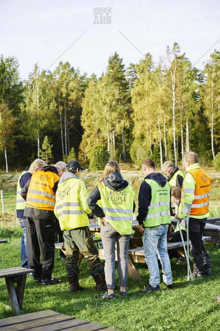 Sweden, Uppland, Rison, Volunteers helping emergency services find missing people