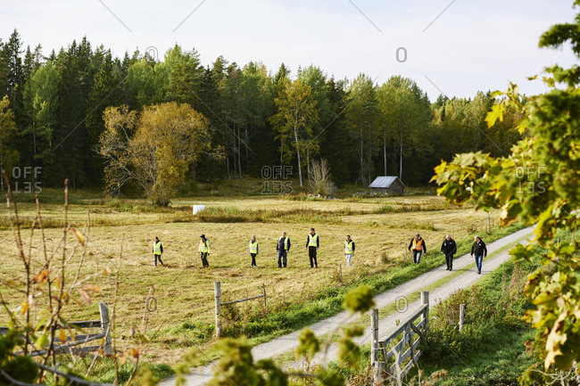 Sweden, Uppland, Rison, Volunteers helping emergency services find missing people