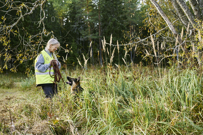 Sweden, Uppland, Rison, Volunteer with dog helping emergency services find missing people