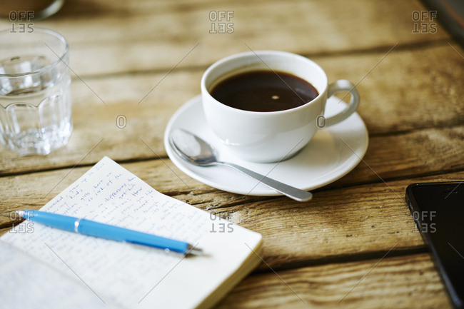 Germany, Notebook and coffee on table