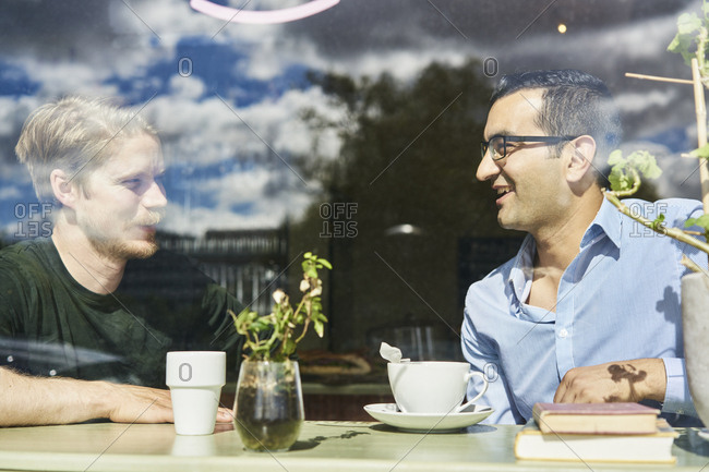 Sweden, Portrait of two mid adult men in cafe