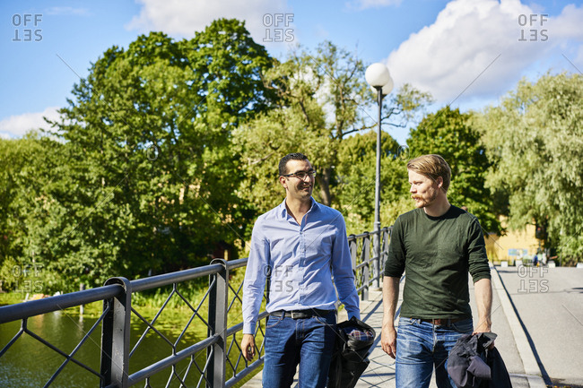 Sweden, Stockholm, Sodermalm, Hornstull, Two mid adult men in park