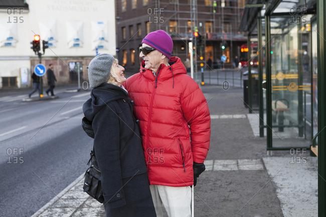 Sweden, Stockholm, Sodermalm, Senior couple waiting at bus stop