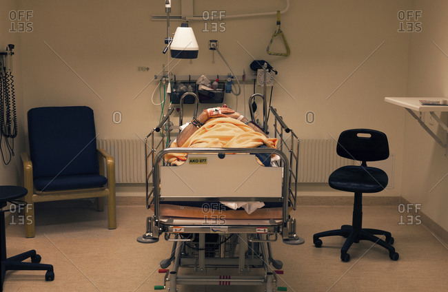 Sweden, Mature man lying down in hospital bed