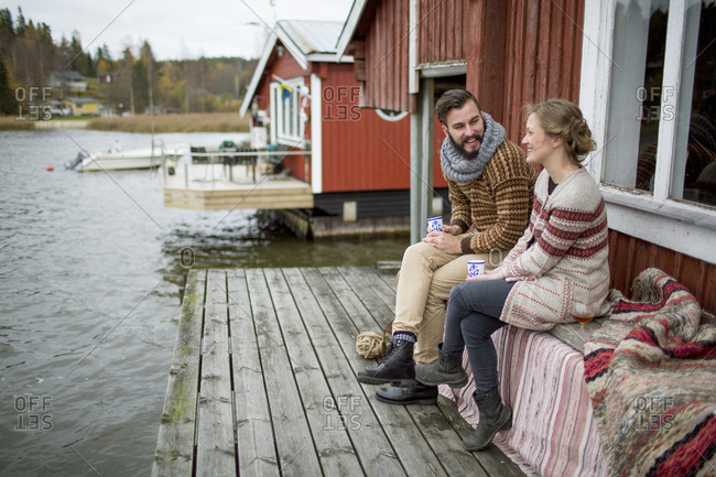 Sweden, Young couple sitting on bench