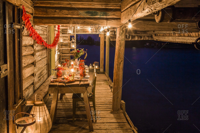 Sweden, Patio with fresh crayfish on wooden table