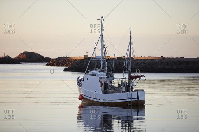 Norway, Lofoten, Boat on scenic lake