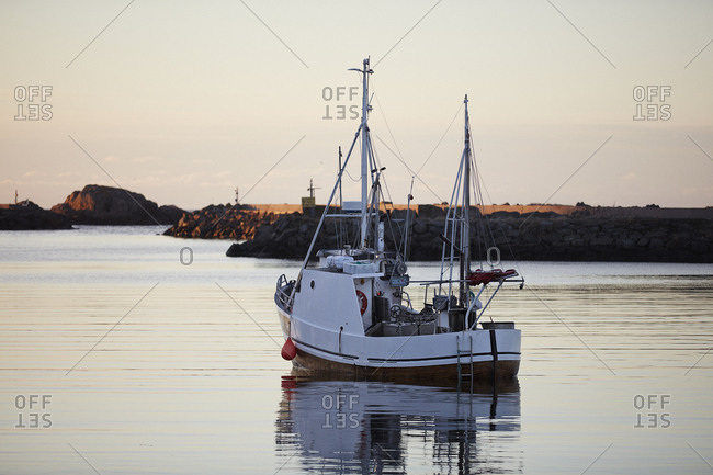 Norway, Lofoten, Boat on scenic lake