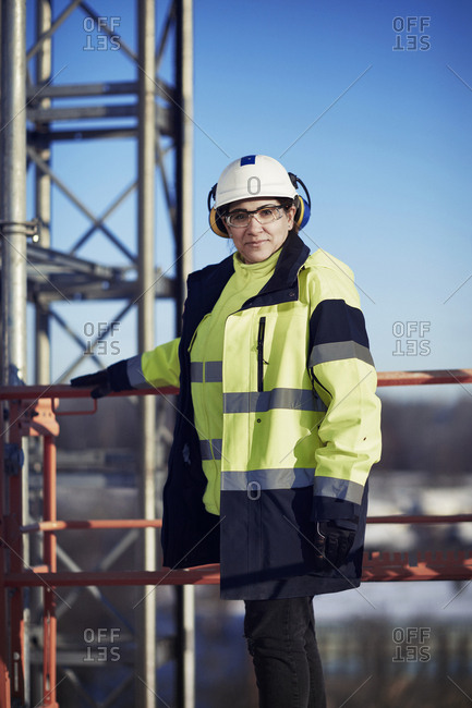 Sweden, Woman in protective clothing looking at camera