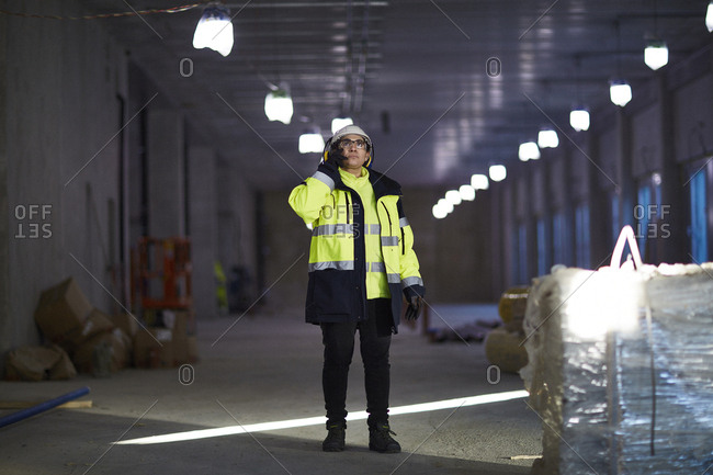 Sweden, Woman in protective clothing using phone