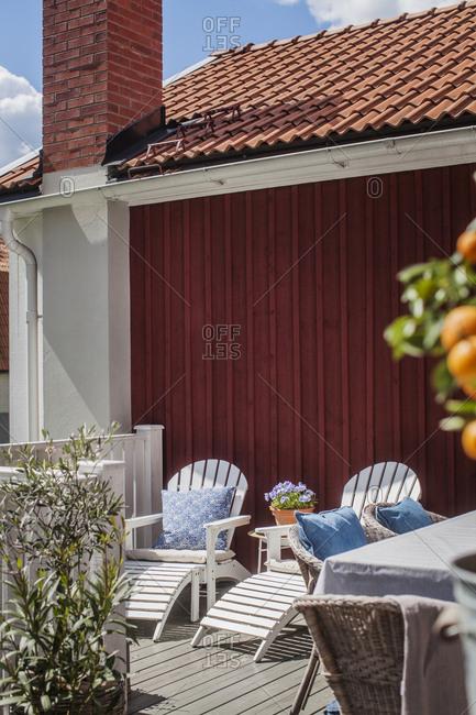 Sweden, Vastmanland, Vasteras, Sunloungers on patio