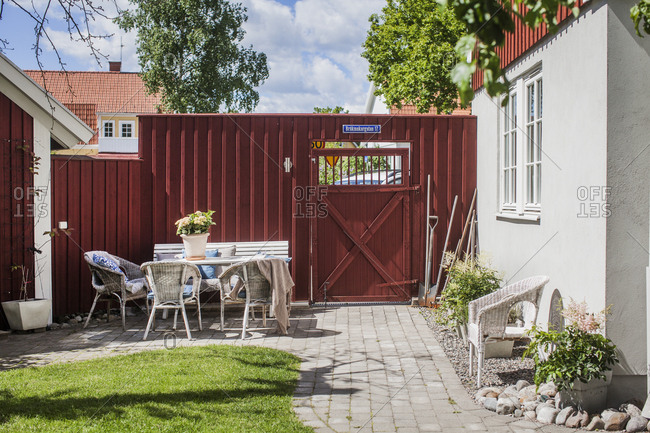 Sweden, Vastmanland, Vasteras, Chairs and table in backyard