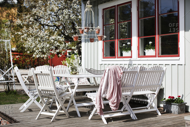 Sweden, Vastmanland, Vasteras, White table and chairs on wooden patio