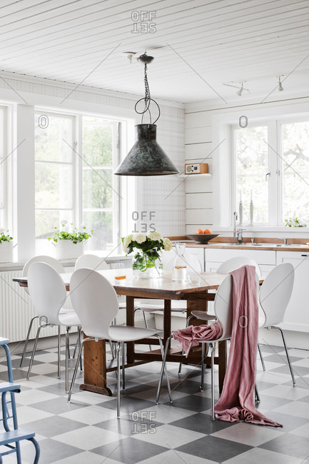 Sweden, Domestic kitchen with white table and chairs