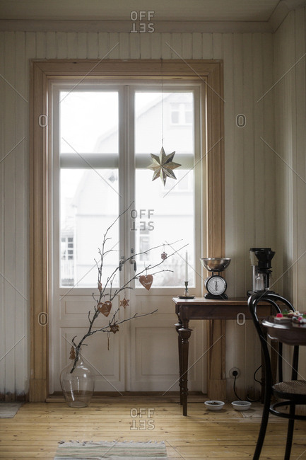 Sweden, Domestic room with branch in vase